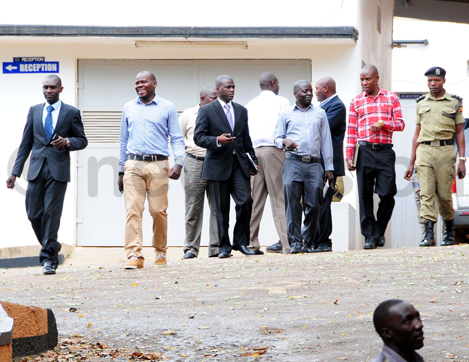 awyer red agolo  a partner at the firm chats with police detectives at the offices in ololo hoto by icholas neal