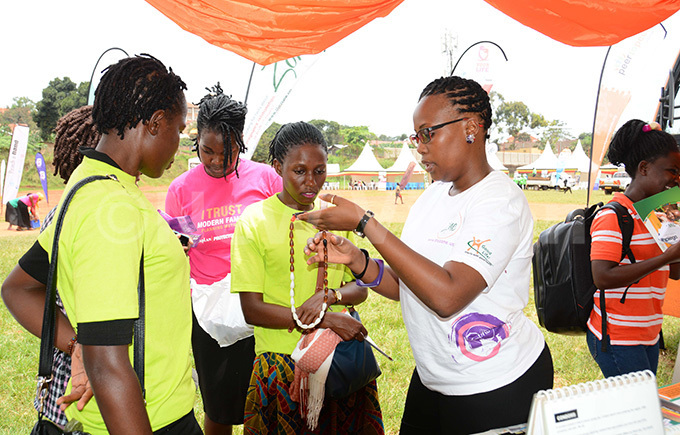 ariettah atende right social behaviour change communications manager explains to the youth about moon beads a method of family planning