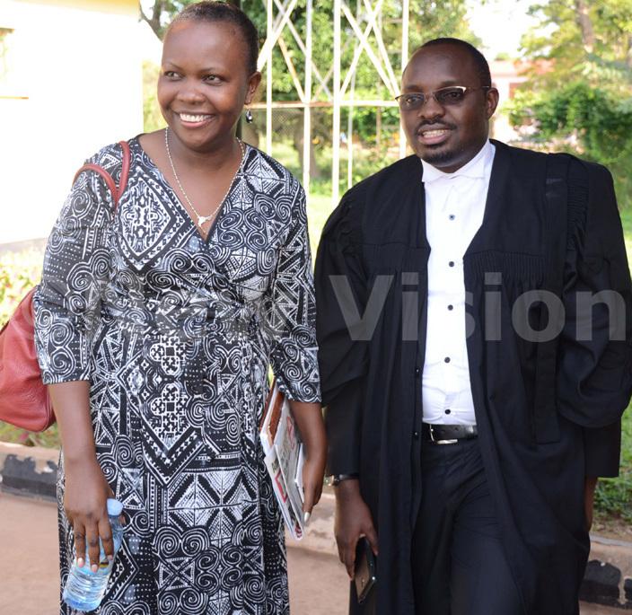 kurut and one of her lawyers saama ebuufu outside ourt