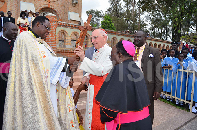 receives a wooden crucifix from the administrator of ubaga athedral r oseph ary buye