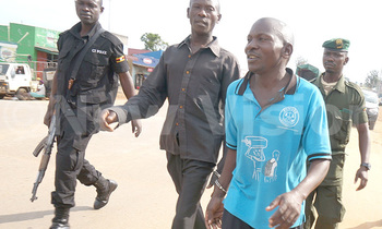 L r joseph mugerwa and ronald naduli being led to mbirizi police station 350x210