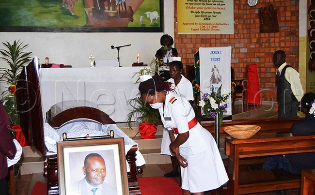 nurse pays respect to r dward dumba during the requiem mass