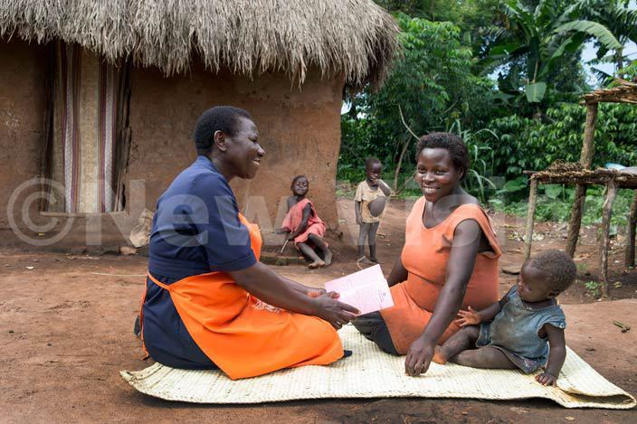 health worker in akaseke ikamulo village advices a mother on how best to ward off malaria