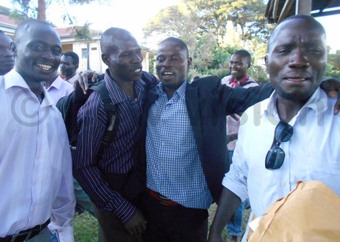 oshua agoole 2nd right celebrates his win with supporters hoto by oreen usingo