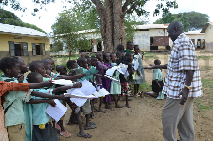 asimeri rimary chool head teacher ouis kello bedism interacts with pupils hoto by loria akajubi