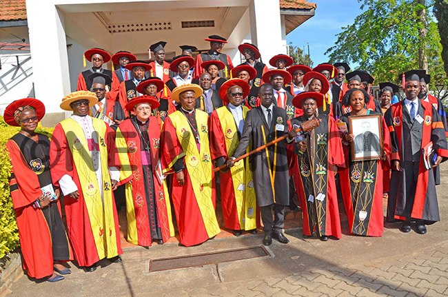 s dons and governing council members with rchbishop uigi ianco thirdlef front row after the graduation function on riday