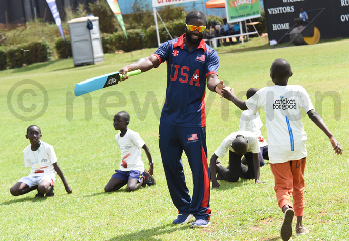 tandford taking youngsters through fielding basics at ugogo hoto by palanyi sentongo