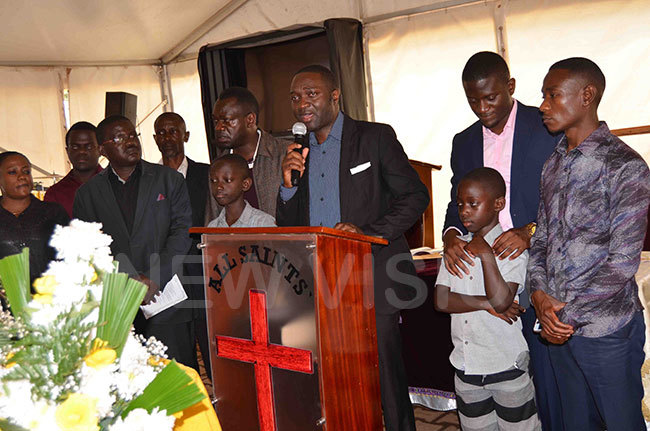 essy itto the husband of the late eborah ercy abukenya eulogises his wife during the funeral
