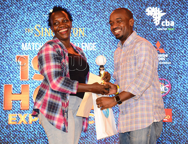 sational ey ccounts anager udith zaru left hands over prizes to roup  winner erwano alusimbi