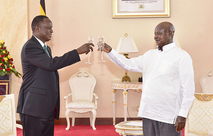 ulius iema ilonzo shares a toast with resident useveni after presenting his credentials  hoto