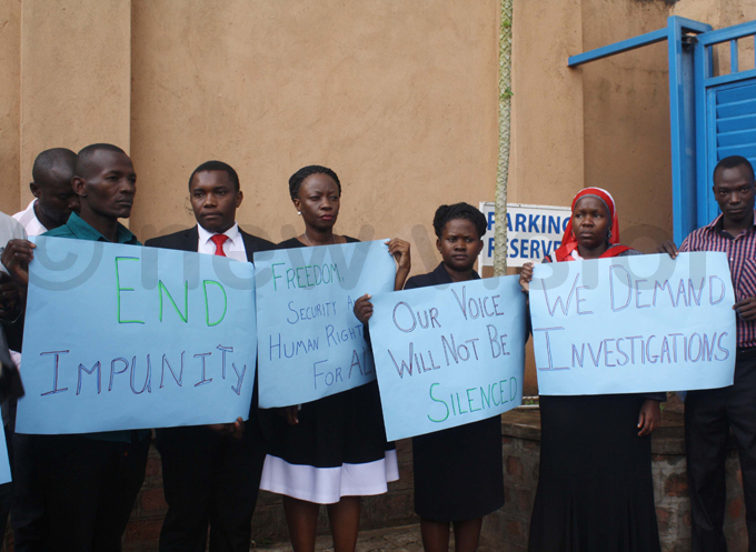 ome of the human rights advocates show off placards protesting the spate of breakins at their offices hoto by eddie usisi