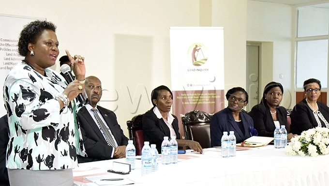 inister for lands etty mongi addresses the land inquiry commission chaired by ustice atherine amugemereirwe 3rd right during the launch of the commission in ay 2017 ile hoto