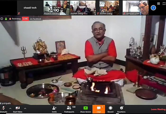 his handout screenshot of a video call on pril 19 2020 received courtesy of haadicom shows priest haran ripathi officiating the wedding rituals of groom ushen ang  in 2nd  at his home in umbai and bride eerti arang not pictured