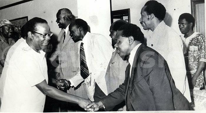 hairman of the ilitary commission aulo uwanga congratulates members of the   at arliament