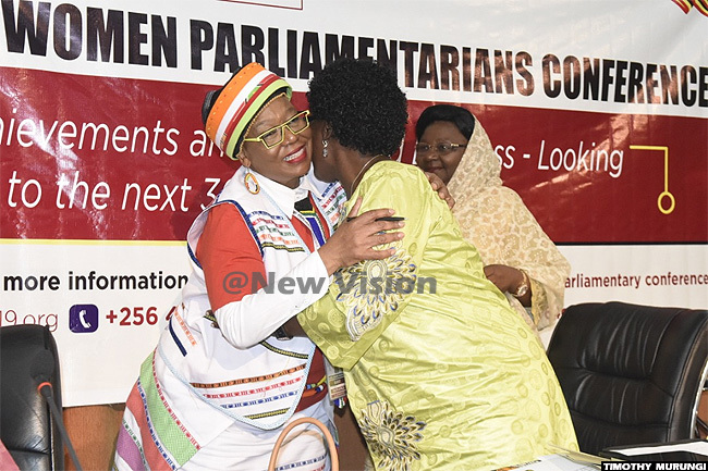 peaker of arliament ebecca adaga shares a light moment with indine aseko as deputy speaker of ameroon and  chairperson milia onjova looks on