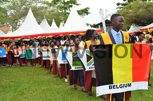 spectacle of students with flags of different countries during the academic procession for s 25th raduation eremony on riday