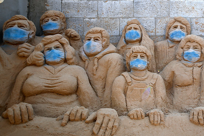 sand sculpture by alestinian artist ana alamlawi is pictured in her yard in aza ity during the novel coronavirus pandemic crisis on pril 3 2020 hoto by ohammed
