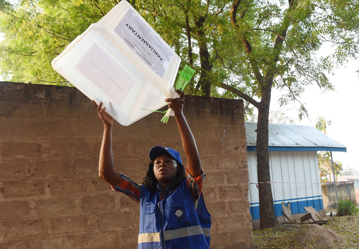 n electoral official raises an empty ballot box to voters at a polling station in ole district in northern hana on ecember 7 2016