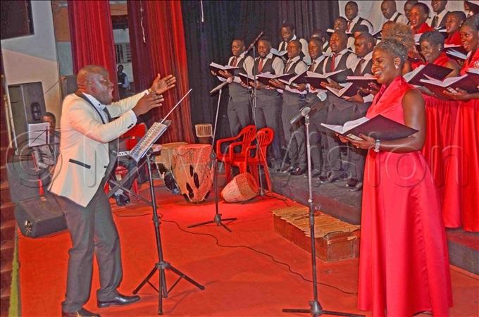 he ranciscan hoir music director mbrose izito conducting the choir