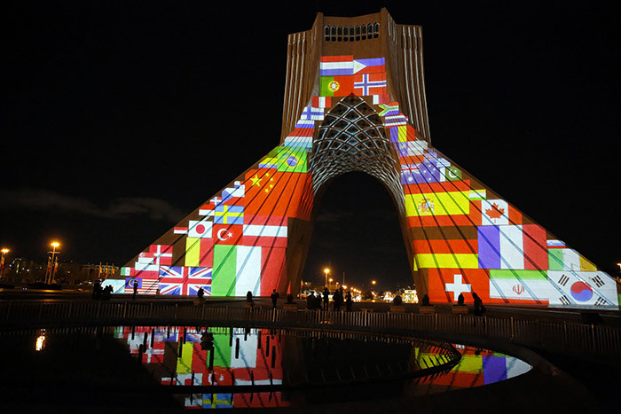rans zadi reedom ower is lit up with flags and messages of hope in solidarity with all the countries affected by the 19 coronavirus pandemic in ehran on arch 31 2020 hoto by
