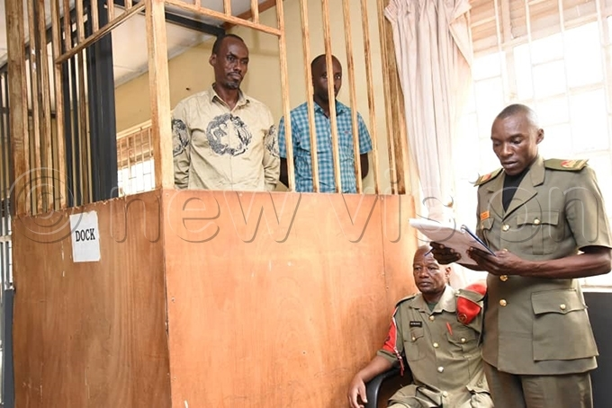 ome of the suspects in the dock at the eneral ourt artial in akindye before their release hoto by palanyi sentongo