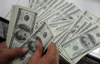 Dollar struggles, Asia markets buoyed as US rate prospects recede