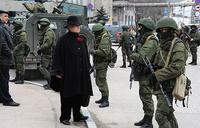 Obama warns Putin over Crimea intrusion