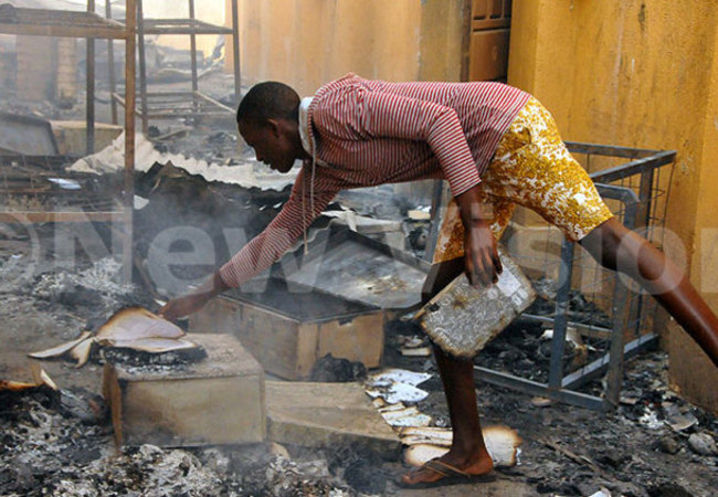 student of elden ollege barara tries to salvage some stuff in the aftermath of the fire redit bdulkarim sengendo