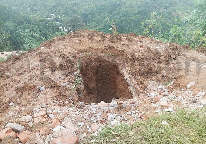 ne of the graves that were dug up for relocation hoto by ilson siimwe