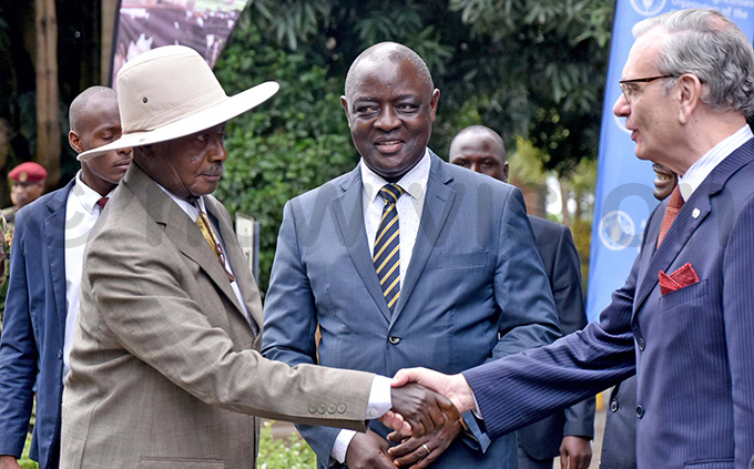 resident oweri useveni greets s orge hediek right while agriculture minister incent sempijja looks on hoto by iriam amutebi