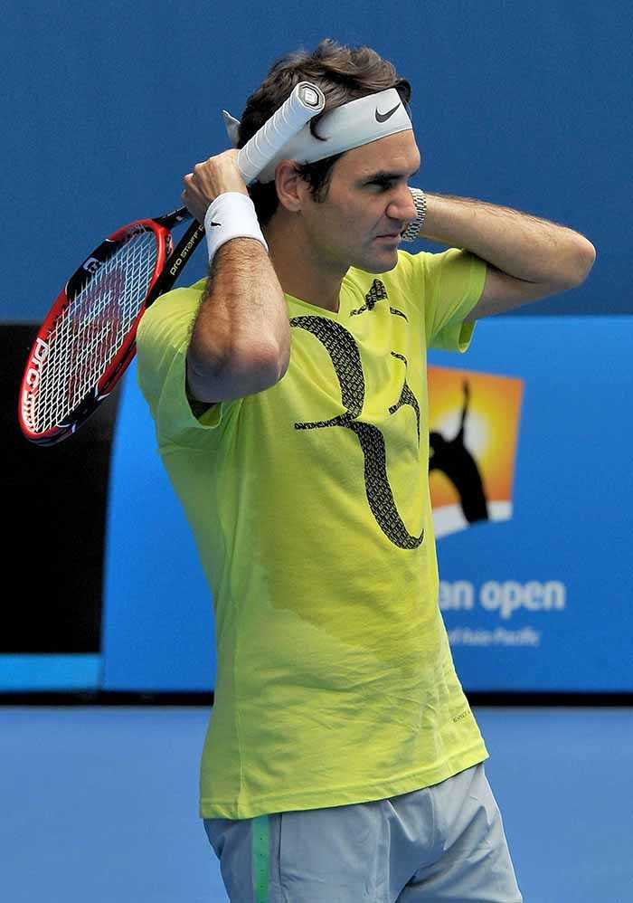 oger ederer of witzerland adjusts his headband during a practice session ahead of the ustralian pen tennis tournament in elbourne on anuary 15 2015 he ustralian pen will take place from anuary 19 to ebruary 1