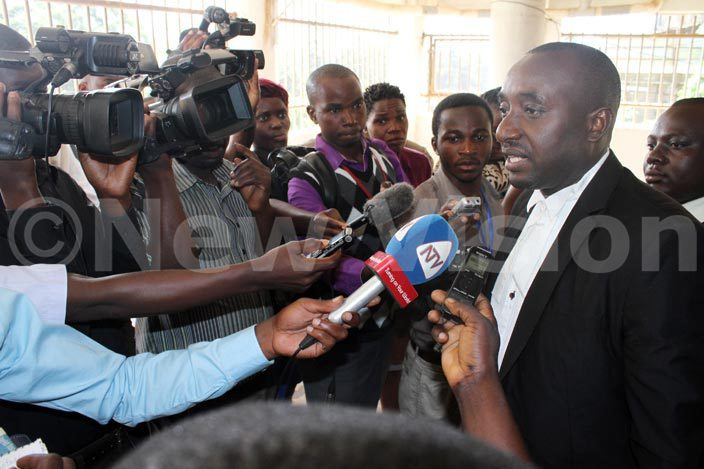 eneral avid ejusas lawyer and son enneth unungu speaks to journalists after the onstitutional ourt adjourned his clients proceedings on arch 10 2016 he ailed former intelligence cocoordinator ejusa has petitioned the igh ourt seeking to suspend the criminal proceedings against him at the eneral ourt artial at akindye
