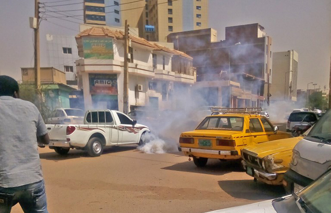 ear gas smoke is seen amidst cars after udanese security forces used it to disperse protesters taking part in an antigovernment demonstration in hartoum  hoto