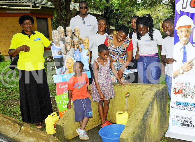 hildren drawing water  from a tap which  was  supported by avis and heriff pump at  children illages akiri  akiso districthe  water pump allows the supply of the water to the children including the health centre used by public hoto by ilfred anya