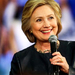 Embattled Clinton steps up drive to court young Americans