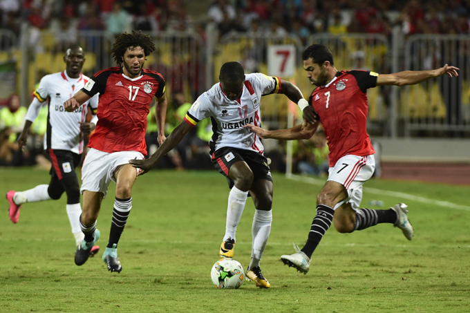arouk iya  is challenged for possession by gypts hmed athy  and ohamed elenny  hoto