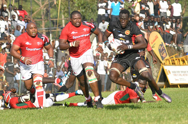 ganda ugby ranes arvin dongo right beats enyas defence for gandas first try during an lgon up match at egends une 10 2017  hoto by ichael subuga
