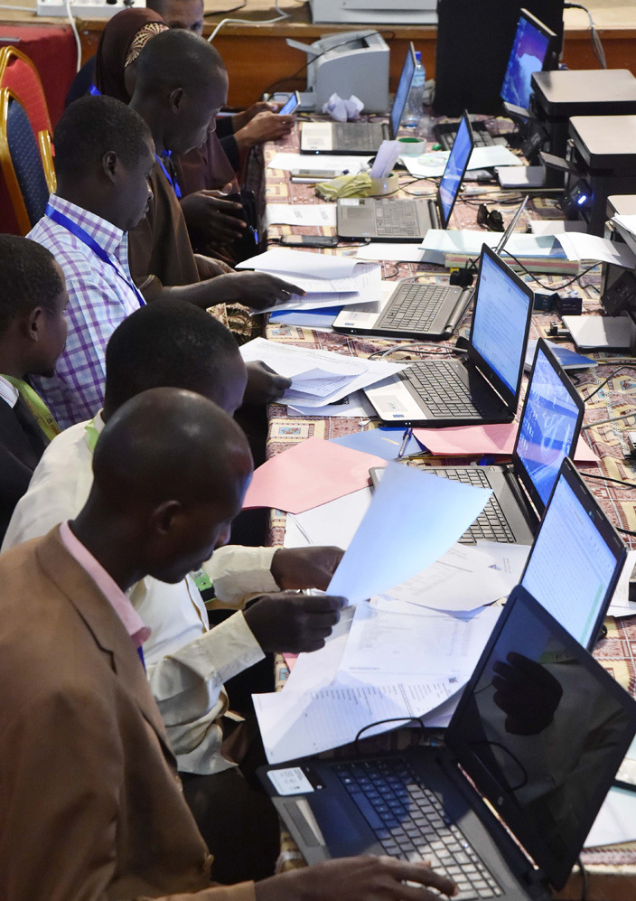 igers ommission electoral indenpendante  technicians check the results of the presidential election on ebruary 22 2016 at the palais des congres in iamey a day after the countrys 1st round presidential and legislatives elections