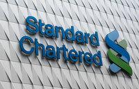 Standard Chartered brings back dividends as profits jump