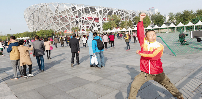 ourists at the eijing ational tadium also known as the irds est