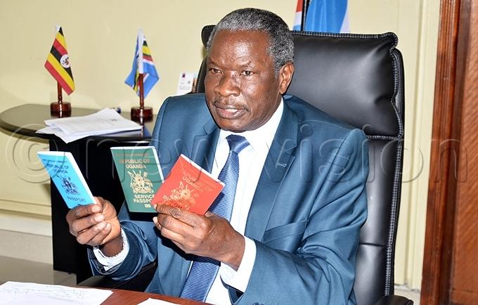 inister ario biga ania displays the new types of gandan passports hoto by onnie ijjambu