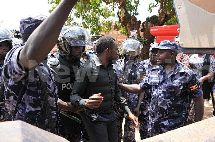 olicemen arresting a student on 23102019