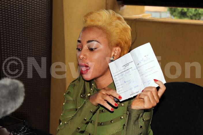 ad lack waves her certificate of release from uzira prison during the press conference at iquid ilk hoto by ajara alwadda