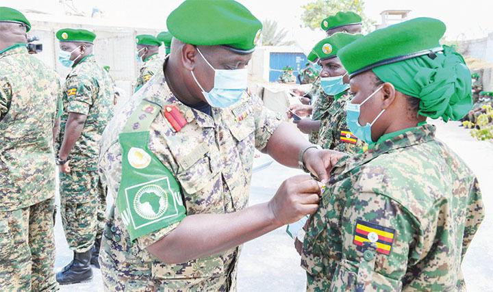 A Battle Group 27 officer receiving a medal