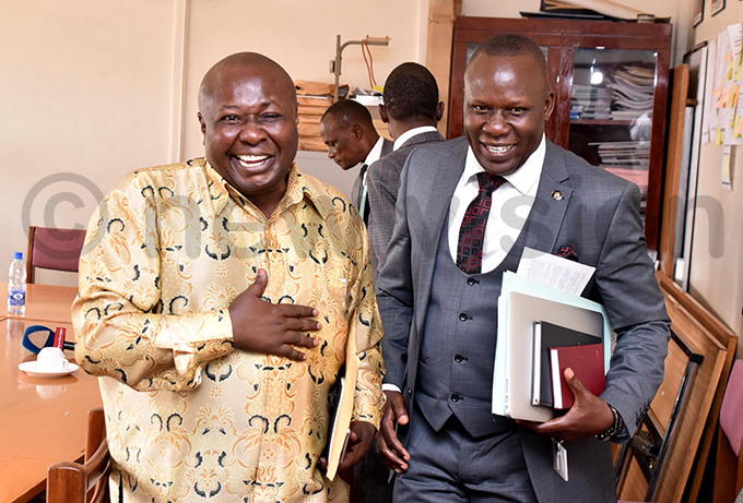 irumira shares a light moment with the chairperson of arliaments infrastructure committee afeero sekitoleko hoto by iriam amutebi
