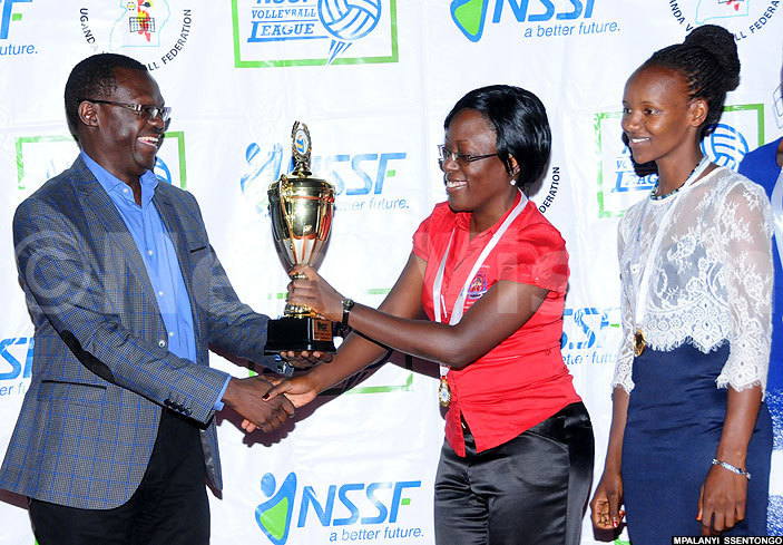 dejje olleball team women being crowned 2015 champions  president adiq asiwu in suit and  chief finance officer handed over the trophy medals and a sh3m dummy cheque to the team