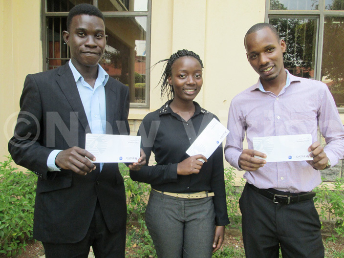 kumba niversitys ean itche ompetition participants ronyu left endo and uhumuza with show off their airtickets