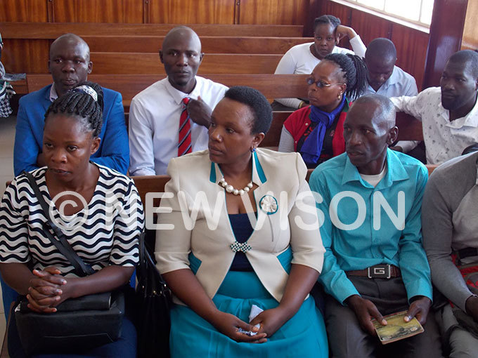 ngrid urinawe center the orum for emocratic hange  womens league chairperson seated with other suspects in court