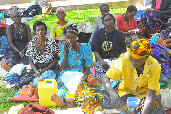ilgrims from oima district relaxing at amugongo artyrs hrine hoto by ilfred anya