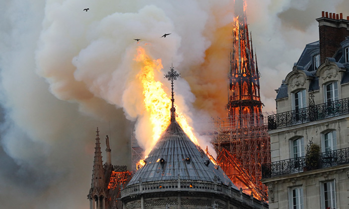 moke and flames rise during a fire at the landmark otreame athedral in central aris on pril 15 2019 potentially involving renovation works being carried out at the site the fire service said hoto by